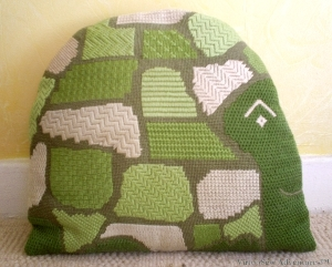 Slow And Steady needlepoint cushion