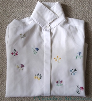 Blouse embroidered with flower sprigs