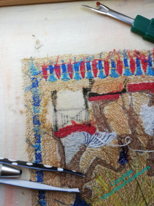 Close up of the back, with a patch bare of stitching where it has been painstakingly removed.