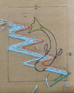 The same canvas as before, now with four rows of stitching in place
